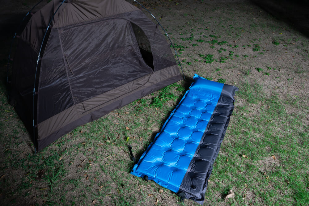 Small Camping Tent and a blue air bed